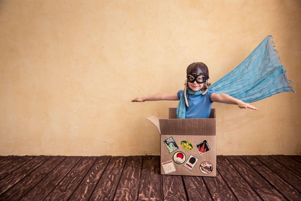 happy kid decluttering boxes