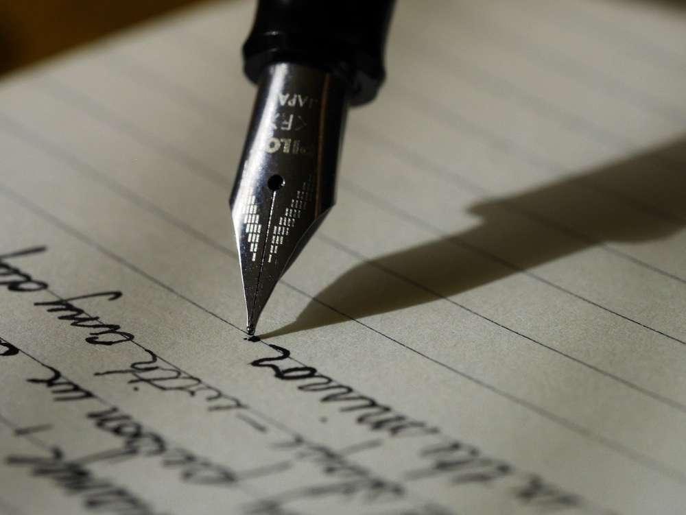 ink pen writing notepad