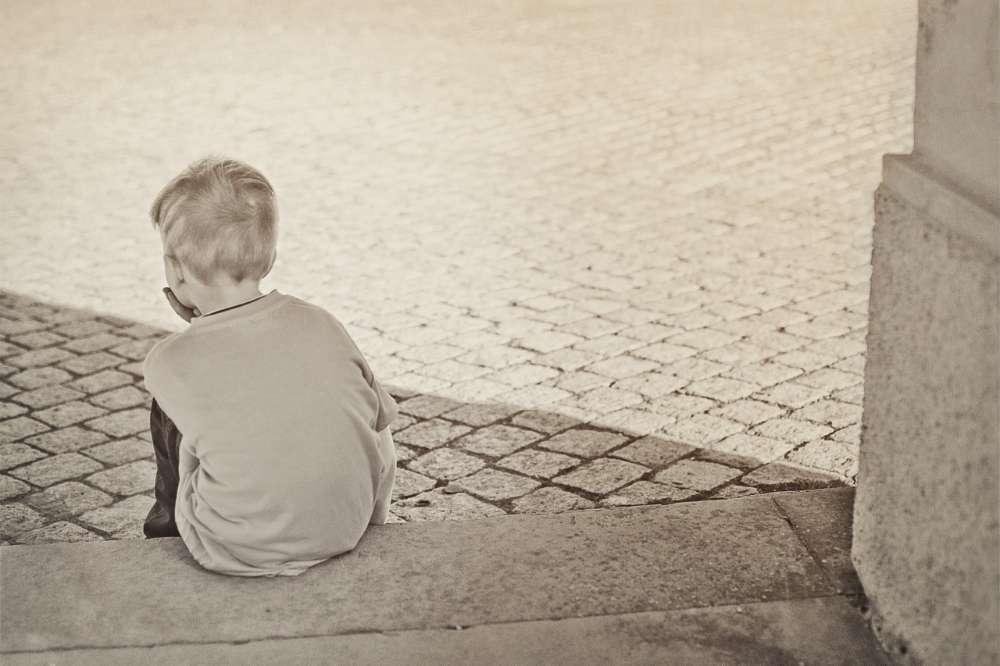 lonely boy thinking reflection