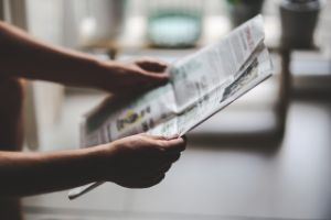 reading newspaper article