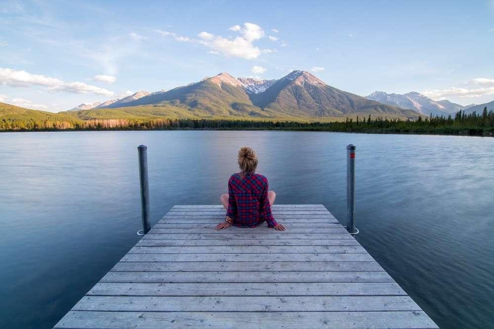 woman pond lake mountain