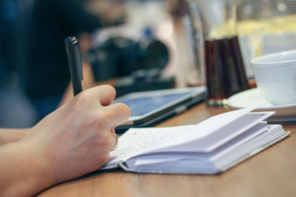 writer writing pen notebook